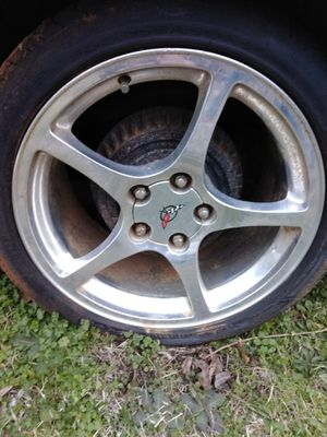 Corvette rally rims with spacers with an extra set of used Perelli racing tires with @65 percent tread...with matching lugs for Sale in Anniston, AL