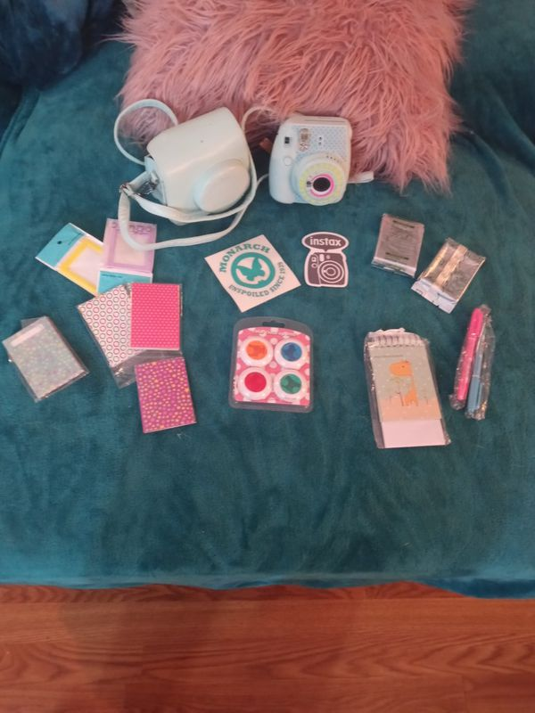 Adorable Polaroid camera with case 2 new film packages and lots of wonderful accessories