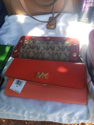 Wallet..s Michsel kors the pink new 2 colors. $80 red brown use but clean $45. for Sale in Banning, CA