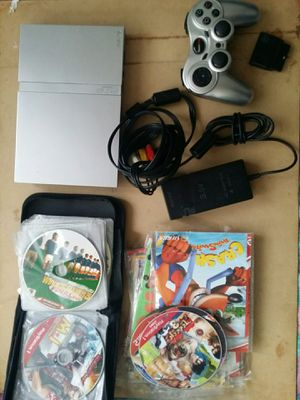 PS2 slim silver come with 1 Controller, av cable, adapter, Power cable, and 45 games for Sale in El Cajon, CA