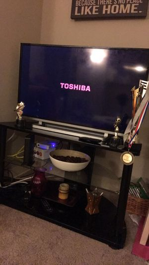 Smart TV with black table and Accessories for Sale in Bala Cynwyd, PA