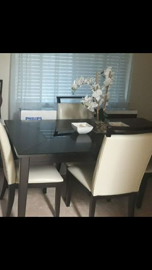 Dark brown dining table with 4 beautiful matching chairs. for Sale in Suitland, MD