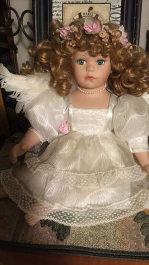 Gorgeous porcelain Angel with soft curls ivory dress and teal feather wings euc 24 inches long for Sale in Northfield, OH