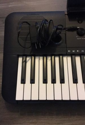 YAMAHA Piano Keyboard w/ Charger & Headphone Jack Adapter for Sale in Chicago, IL