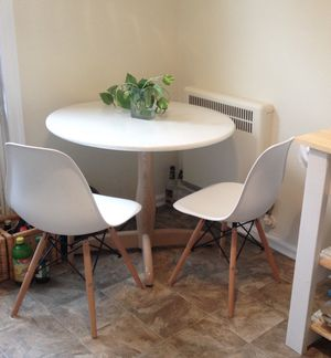 Pedestal dining table and 2 Eames style Eiffel chairs for Sale in Columbus, OH