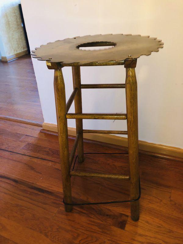 Repurposed antique saw blade table