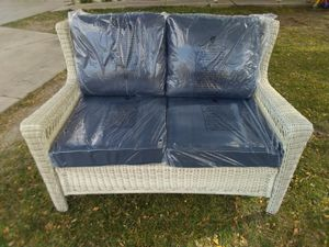 New PATIO FURNITURE LOVESEAT WITH MIDNIGHT CUSHIONS WICKER OLEFIN OFF WHITE for Sale in West Valley City, UT