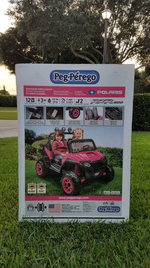 """"""" New in box"""" Peg Perego Polaris RZR 900 - Pink comes with a 12-volt rechargeable battery and a charger. for Sale in Boca Raton, FL"""