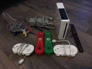 Wii system with Mario Kart (no game case) for Sale in Industry, CA