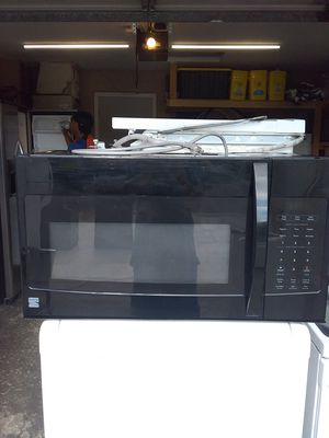 Black Kenmore over the range microwave bracket and screws included in excellent working condition for Sale in Kissimmee, FL