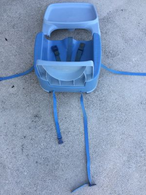Babies booster seat has straps for back of chairs to keep baby from falling and also removable tray great condition for Sale in Port St. Lucie, FL