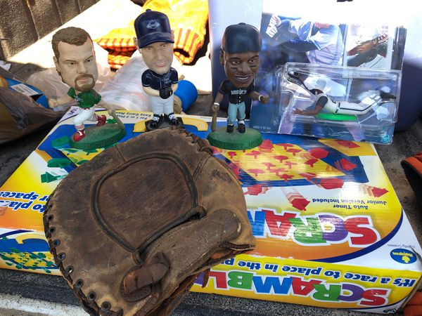 Baseball glove from the 1940s can Griffey Junior bobble head Roger Clemens bobble head and Mark Maguire and Ken Griffey Junior's mom starting lineup
