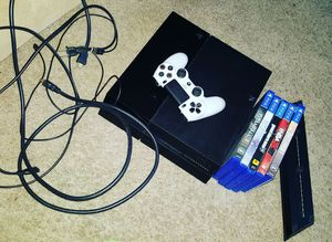 Ps4 games and stand for Sale in St. Louis, MO