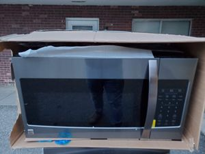 New black Kenmore stainless steel microwave good working conditions for $149 for Sale in Denver, CO