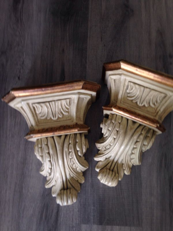 2 decorative gold-accented wall mounts/wall shelves for decor