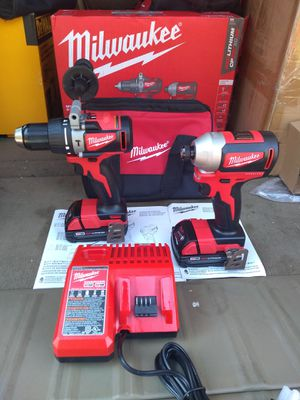 MILWAUKEE M18 BRUSHLESS. HAMMER DRILL , IMPACT DRIVER WITH 2 BATTERIES , CHARGER AND BAG. NEW. NUEVO for Sale in Atlanta, GA