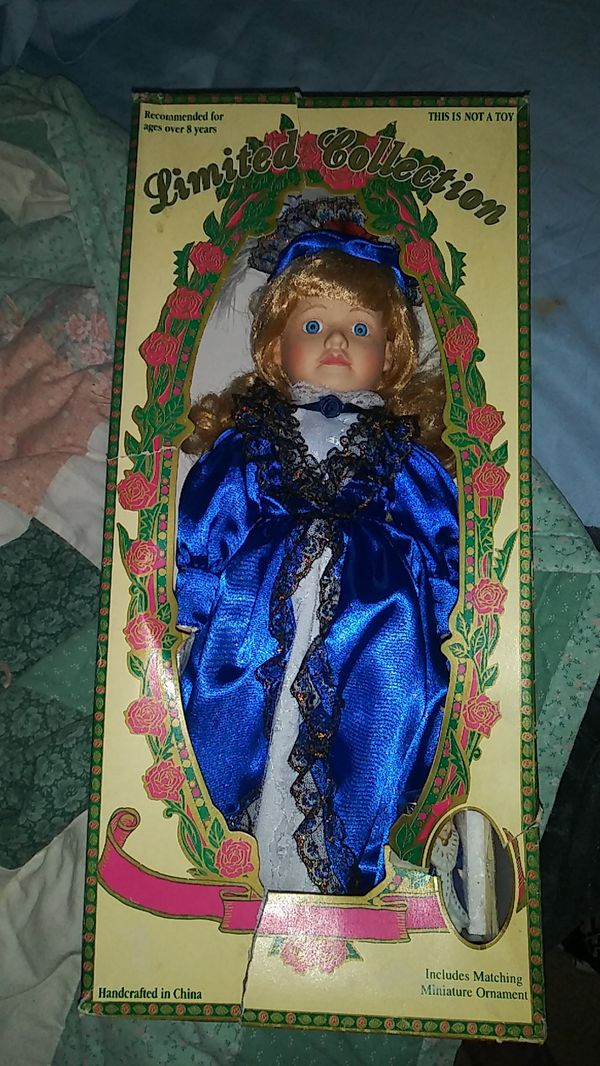 PORCELAIN DOLL. STILL IN UNOPENED BOX. INCLUDES MATCHING ORNAMENT