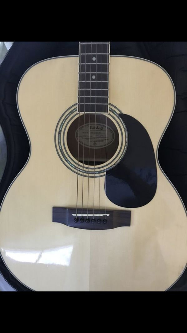 Mitchell acoustic guitar and roadrunner guitar bag