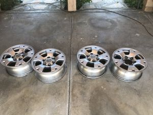 """Tacoma alloy wheels 16"""" , set of 4 , three caps for Sale in Canyon Country, CA"""