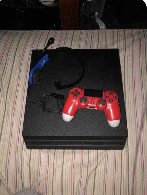 PS4 Pro with controller and cables