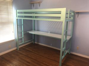 Mint green lofted twin bed with desk below for Sale in Dallas, TX