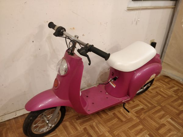 Nice Blossom electric scooter with charge and storage under seat in good condition