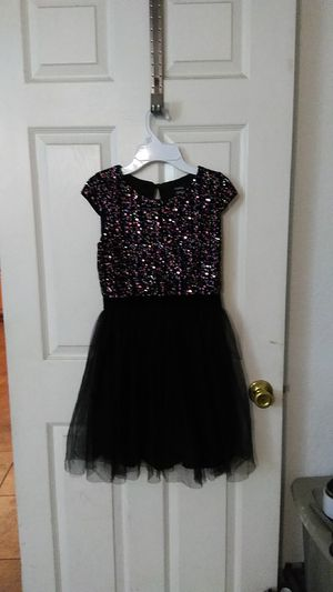 Nice Holiday dress with Sequence on top.full button dress with under slip. 12.00 O.B.O. size 12 for Sale in San Bernardino, CA