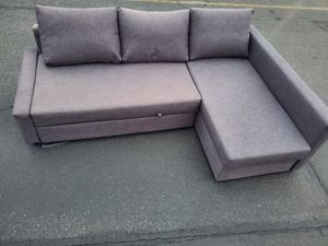 Sectional couch with pull out bed , 650$ in ikea for Sale in Seattle, WA