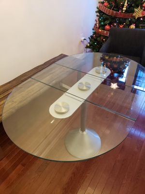 Foldable glass breakfast table with 4 chairs for Sale in Germantown, MD