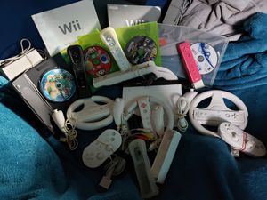 Nintendo Wii 7 co trollers three wheels five nunchucks two adapter controllers two power supply's one av plugins two Wii manuals pmus for Sale in Aberdeen, WA