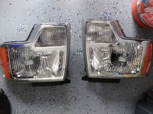 2009 to 2014 Ford f150 headlights and 8000kwatt blue bulbs, and match fog lights. New. for Sale in Port Richey, FL