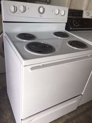 Whirlpool white electric stove in excellent condition plus 6 months warranty for Sale in Pompano Beach, FL