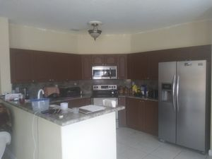 Kitchen cabinets ready for pick up plus counter top double sink the price is 800.00 firm for Sale in Miami, FL