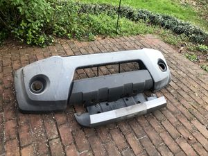 Free Nissan Xterra spare rim and bumper MUST TAKE ALL for Sale in Sudley Springs, VA