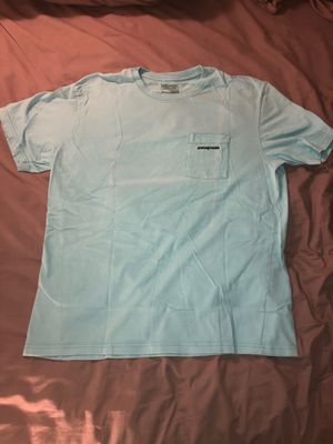 Baby blue Patagonia front pocket tee for Sale in Austin, TX