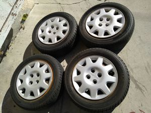 Acura Honda 4x100 OEM Wheels Steelies w Caps with 195/60/14 Tires 85% Tread for Sale in Westminster, CA