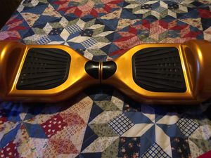 Goldish Yellow Hoverboard for Sale in Tacoma, WA