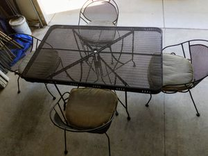 Heavy duty metal patio table and 4 chairs with cushions for Sale in Chico, CA