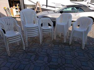 Resin white patio chairs (six with high backs) the remaining 24 are regular size. for Sale in Freehold, NJ