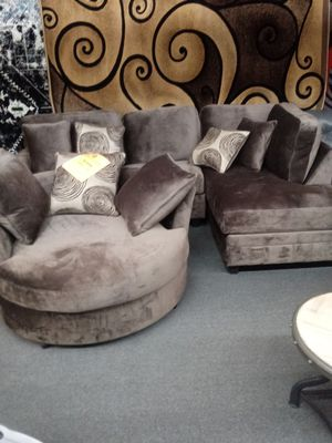 Chocolate champion swivel chair and sectional for Sale in Greensboro, NC