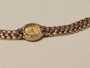 Woman's Elgin watch gold color with silverhearts on band has some diamonds missing for Sale in Fort Worth, TX
