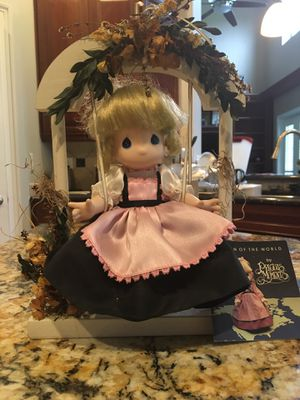 """Precious Moments Doll perched on a wooden country swing. Approximately 8.5"""" W x 12"""" H. for Sale in Clermont, FL"""