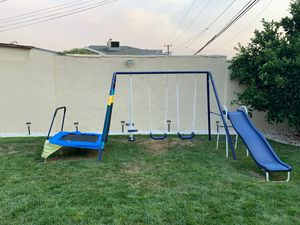 Kids swing set attached 3 swings slide and jumper gently used for Sale in Glendale, CA