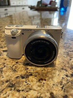 Sony Alpha a6000 24.3 MP Digital Camera with E PZ OSS 16-50mm Lens - WHITE for Sale in Albert,  OK
