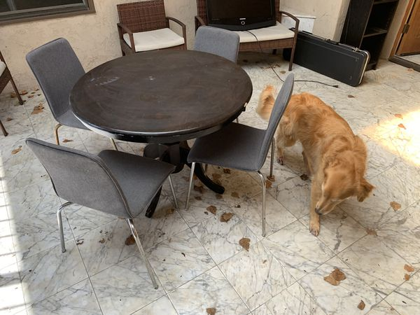 Breakfast table with four chairs