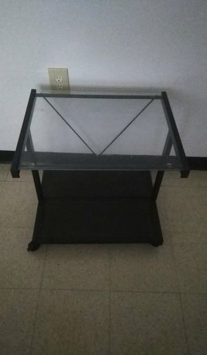 Tv stand on wheels with glass top asking $10. Avon Park pick up only for Sale in Avon Park, FL
