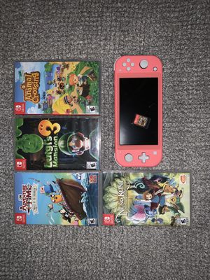 Nintendo switch lite. Coral with 5 games. for Sale in Las Vegas, NV