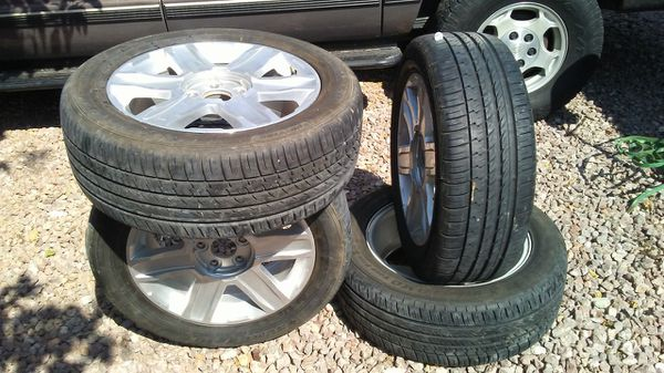 I have a set is brand new tires and wheels for GM 5 lug no caps.