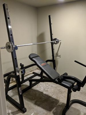Rock fit weight bench with squat rack and weight tree for Sale in East Wenatchee, WA