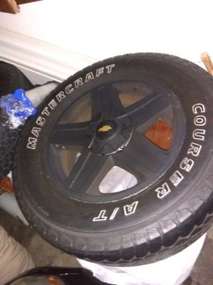 SUV tires(4) Rims&tires w/Chevy hubcaps gold &black for Sale in Obetz, OH